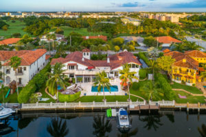 7400sf Waterfront Mediterranean Estate is located in Diplomat Golf Estates on a 1/2 acre with 143ft of waterfront.